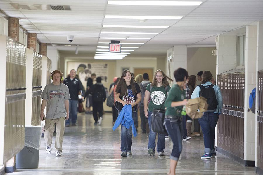 Students and staff walk the halls during a passing period on Oil Bowl Friday.