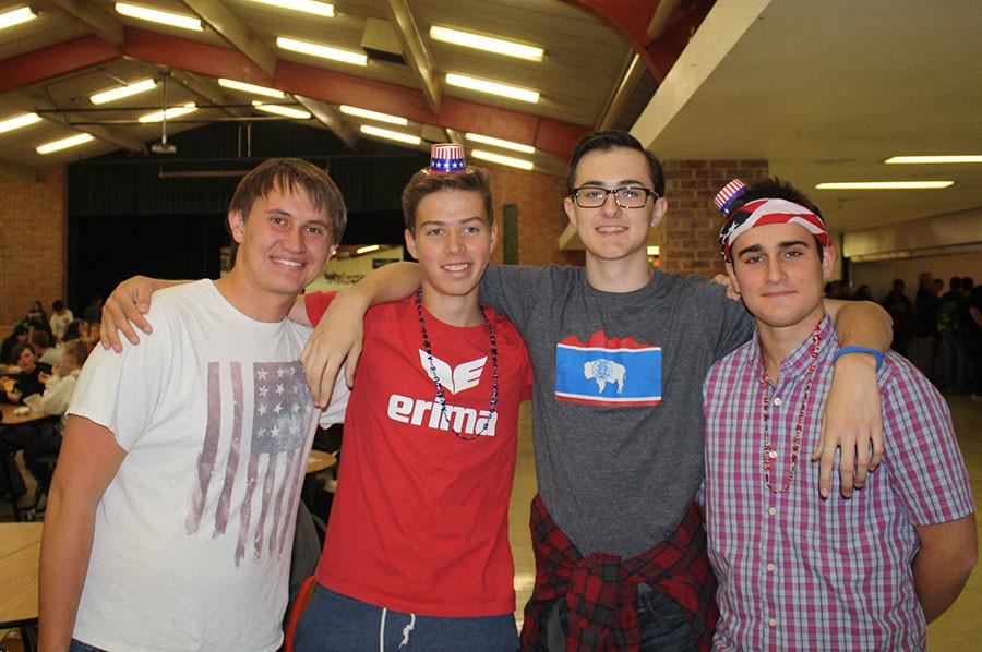 Tanner Christensen, Noah Kaufmann, Dalton Blase and Pepe Goerlich-Leon wear their red, white and blue for 'Merica Monday of homecoming week.  Kaufmann and Goerlich-Leon are foreign exchange students from Switzerland and Spain and are experiencing their first American spirit week at KW.