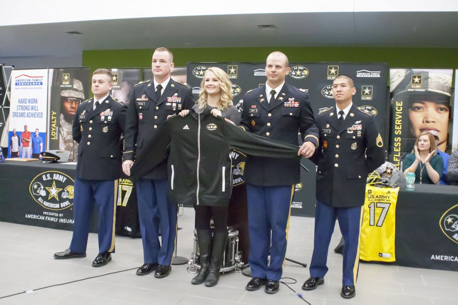 Officers of the U.S. Army present KW senior, Lia Kopp with a jacket and an invitation to take part in the All-American Bowl half time show.  Kopp will perform with the nations best high school band musicians in San Antonio on January 7th.