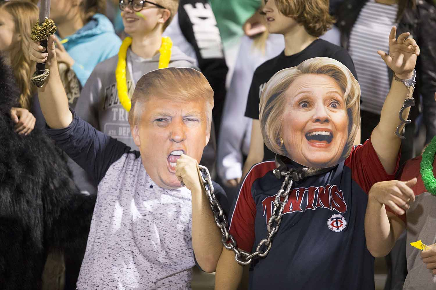 Juniors Thayne Macy and Willis Schneider don Hillary Clinton and Donald Trump masks at the home football game against Cheyenne south.  The presidential election has been the story of the year nationally and locally too.
