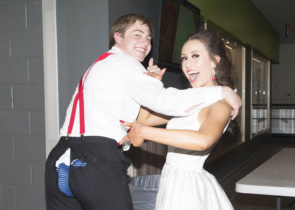Juniors Joey Geil and Mackenzie Kern laugh at the fact that Geil pants split during Prom.  Geil and Kern have been dating for a couple of years now.