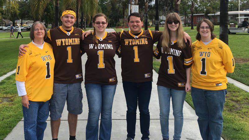 The Wyoming team displays their Wyoming pride in a team photo at the California School for the Deaf in Riverside California.