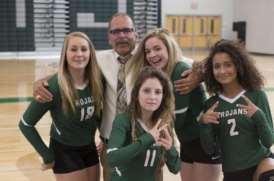 Principal Brad Diller pals around with seniors Maddie Dedic, Hallie Jimenez, Jill Phipps and Jaliegah Davis during their team photo day.  Diller has announced that the 2017-2018 school year will be his last as he is retiring.