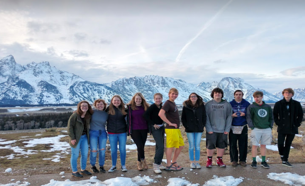 The 12 Member Kelly Walsh Model UN team in front of the Tetons in Jackson.