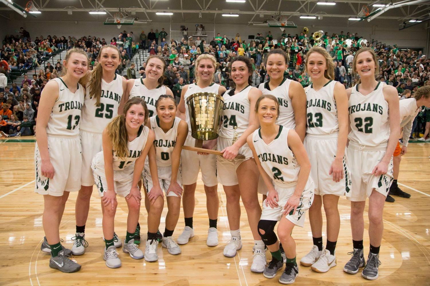 The Lady Trojans pose with the Peach Basket Trophy for the first time in 8 years.  The Lady Trojans won 51-42.  The Trojans also won the trophy on the boys side with a final score of 55-47.  This is the first time both trophies will both be at KW since 1996.