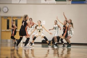 Katie Farley, Elayna Chafee, Riley Alberts and Barrett Lloyd play. defense during the first home basketball game of the winter season.  Many athletes are concerned that they won't get to see the winter sports season through due to Covid-19 concerns.
